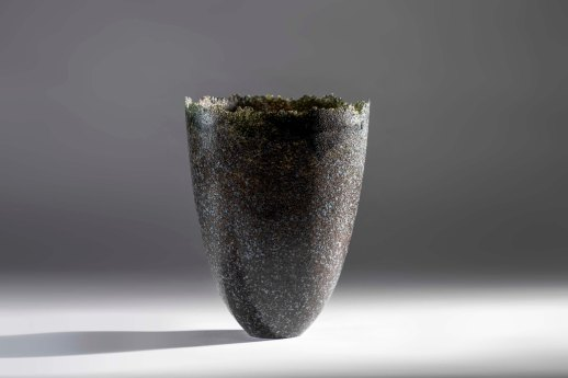 Tall vessel with polished surface